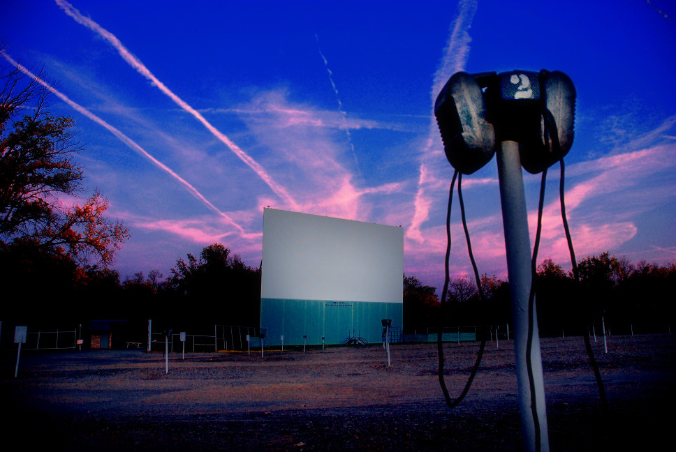 Boulevard screen at dusk with vapor trails