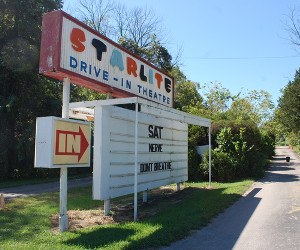 Starlite Drive-In marquee pointing to the entrance road