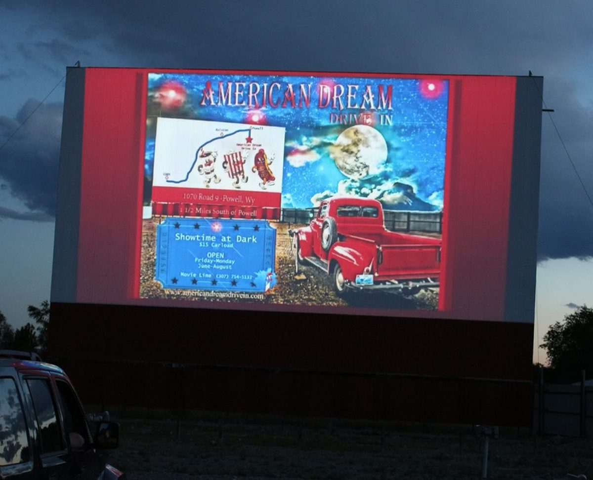 Drive-In screen showing an advertisement for the American Dream Drive-In