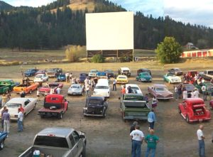 Previous, narrow screen at the Auto Vue Drive-In with a full field of cars