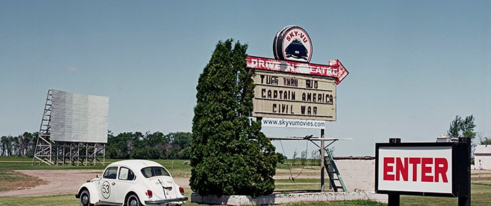 Sky-Vu Drive-In entrance sign, marquee, screen, and VM Beetle