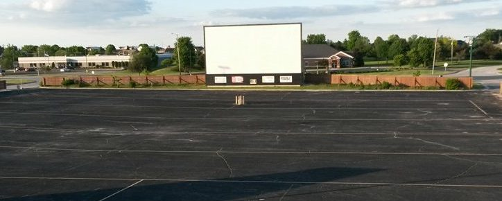 Drive-In screen seen across a paved parking lot