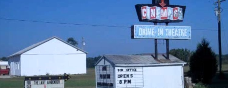 Cinema67 Drive-In marquee and separate sign showing movie titles