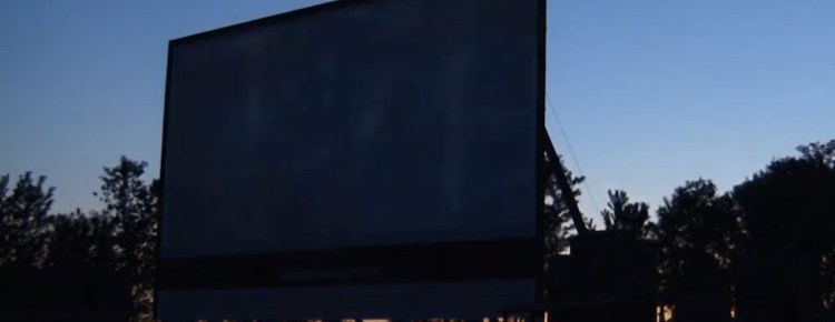 The Boonies Drive-In screen at twilight