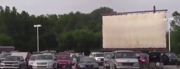 Screen and cars at the Summer Drive-In