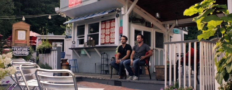Paul and John Stefanopoulis sitting in front of their concession stand