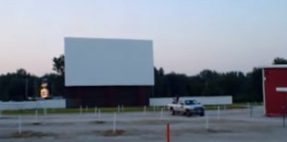 Midway Twin Drive-In screen with marquee in the distance