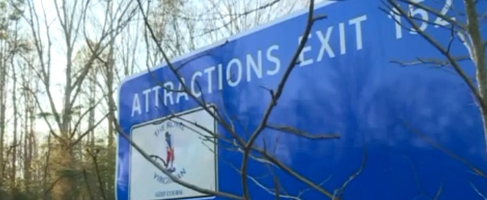 """Highway sign that says """"Attractions Exit 152"""""""