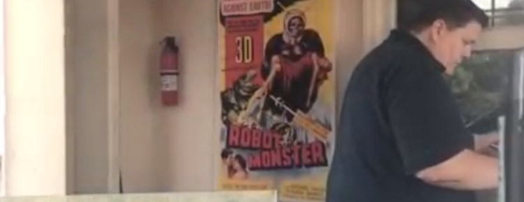 Drive-In patron next to Robot Monster poster
