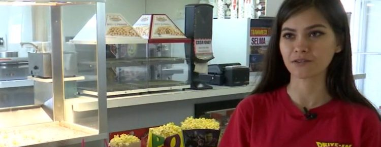 Dulce Garcia, an employee of the Madera Drive-In, with an array of snacks