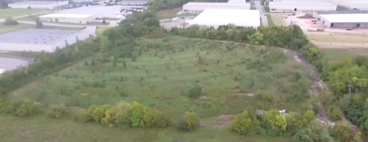 Aerial view of the overgrown remains of the Holiday Drive-In