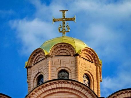 Puerta de Oro. Detalle de la Cruz con el Ancla