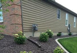 Ranch style home in cedar siding upclose