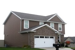 driftwood-roof-white-trim-white-carriage-style-garage-door-royal-natural-cedar-siding-normal-il-blackstone