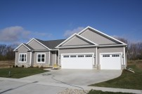 royal-harvard-slate-grey-siding-white-trim-royal-harvar-slate-board-and-batten-certainteed-landmark-in-driftwood-white-carriage-style-garage-door-in-downs-il