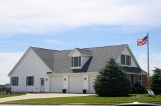 White colonial home with grey roof