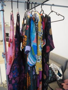 A rack of colourful clothes.