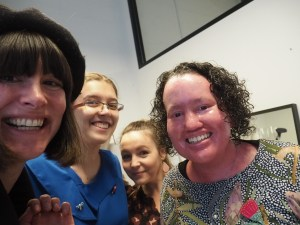A selfie featuirjg four women smiling for the camera