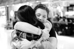 Tender hugs with family