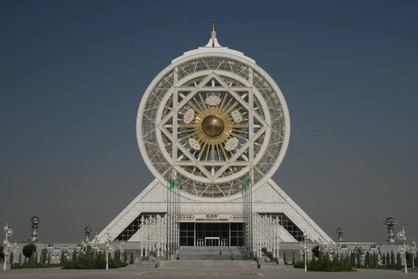 An enclosed ferris wheel is just one of the strange buildings in the capital of Turkmenisatn