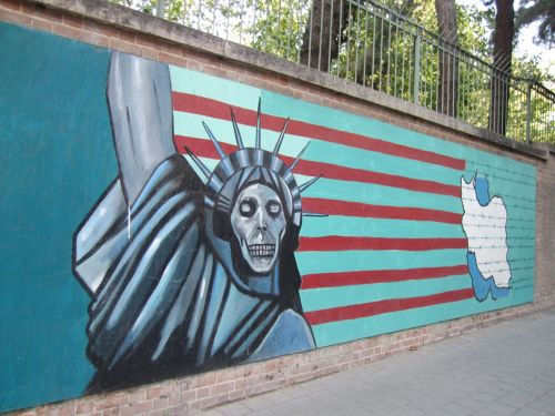 Graphic murals outside the US Den of Espionage