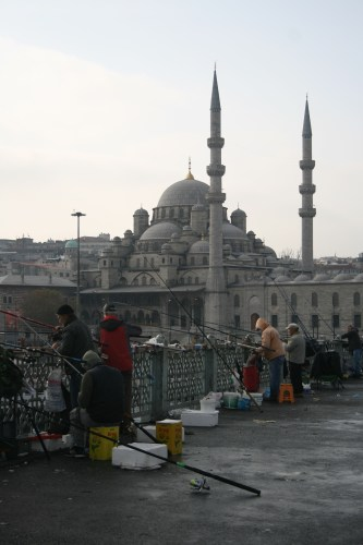 Fisherman on Galata Bridge and Yeni Cami