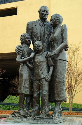 "African American Slavery Monument in Savannah, GeorgiaThis monument was erected in 2002. It depicts a black family in a tight embrace with broken shackles at their feet. The inscription is by Maya Angelou: ""We were stolen, sold and bought together from the African continent. We got on the slave ships together. We lay back to belly in the holds of the slave ships in each others excrement and urine together, sometimes died together, and our lifeless bodies thrown overboard together. Today, we are standing up together, with faith and even some joy."""