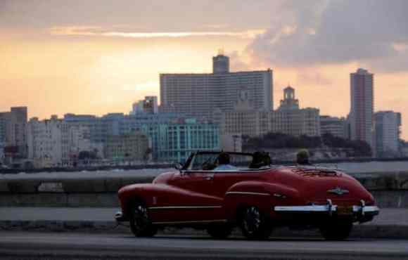 A convertible car on Havana's El Malecon at sunset (reuters/Desmond Boylan)