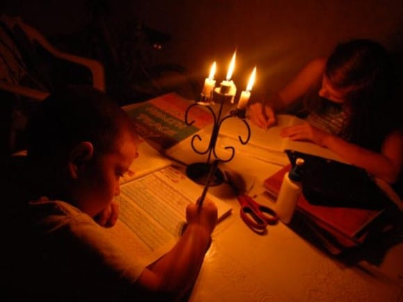 Kids doing homework in the dark in Cuba