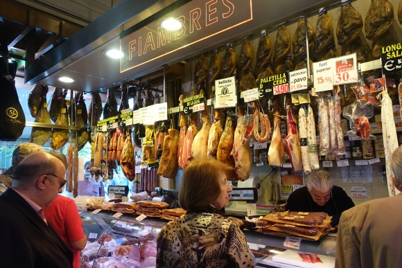 In Ferpal people waiting to buy ham - Madrid Food Tour
