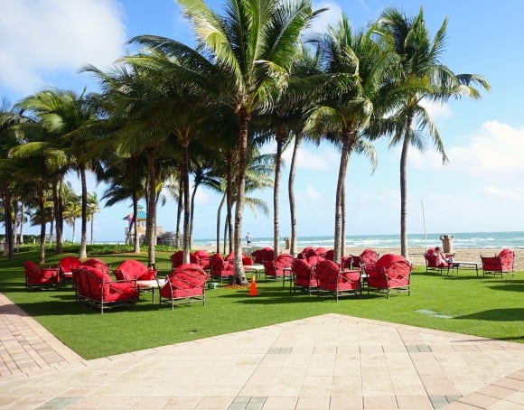 Costa Grill seating area near the beach at Acqualina