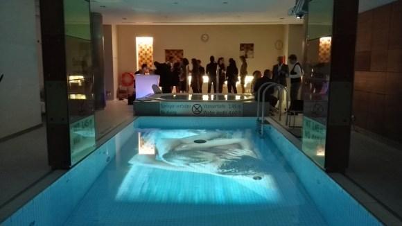 Visual artist Gerald Herlbauer scenes from the film La Piscine in the water.
