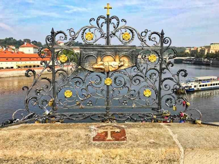 On the Charles Bridge, one of the Baroque Shrines that people rub for good luck