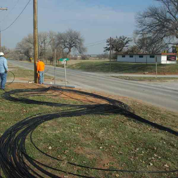 """These huge lengths of fiber optic cable lay on the ground in a giant """"figure-8"""" pattern as our contractors prepare to pull them into a conduit under the highway."""