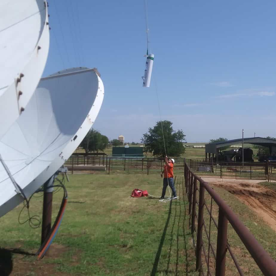 Workers from MUTI raise a replacement antenna and radios on our North Carnegie site. The old antenna had been struck by lightning early the previous morning, during a brief but powerful storm.