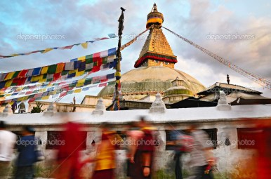 Buddhist pilgrims walks around Boudhanath Stupa - the largest stupa in Nepal, Kathmandu