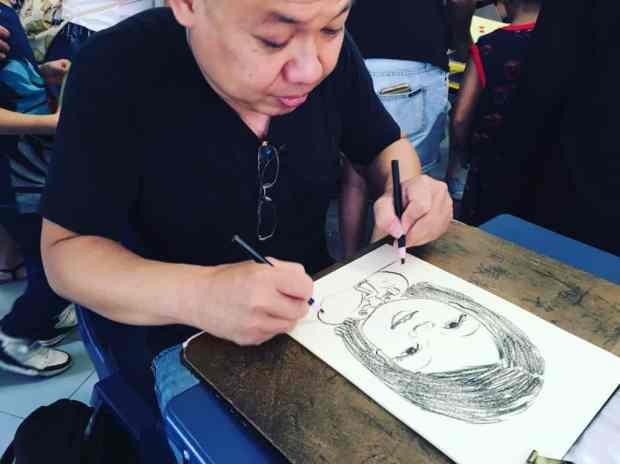 2 hands caricature artist