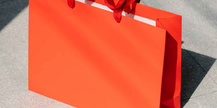 red paper shopping bags on floor