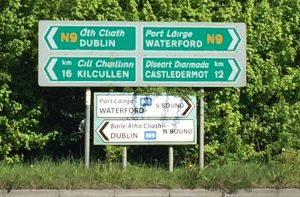 Road signs in Ireland provide directions and a lesson in Irish.
