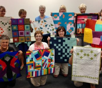 Some of the mini quilts made for the Modern Traditionalism Challenge