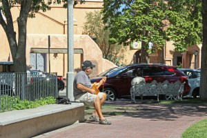Guy playing cigar case guitar Plaza Albuquerque_edited-1