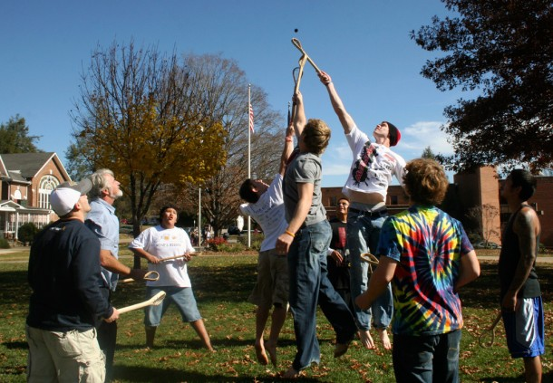 Mars Hill College students play a game of stickball in 2011 with members of the Eastern Band of the Cherokee Big Cove Community. Photo courtesy of Mars Hill College.