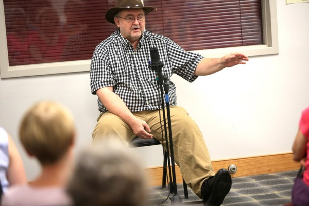 'I could always feel like time rolled back when I heard these songs and thought about how people lived long, long ago,' says Bobby McMillon, a N.C. Heritage Award winner and Burnsville-area resident, seen here performing at the Weaverville Library in August. Colby Rabon/Carolina Public Press