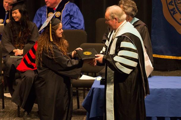 Keri Leann Arrington, of Marshall, N.C., receives her diploma from Mars Hill University President Dan Lunsford. Photo courtesy of Mars Hill University.