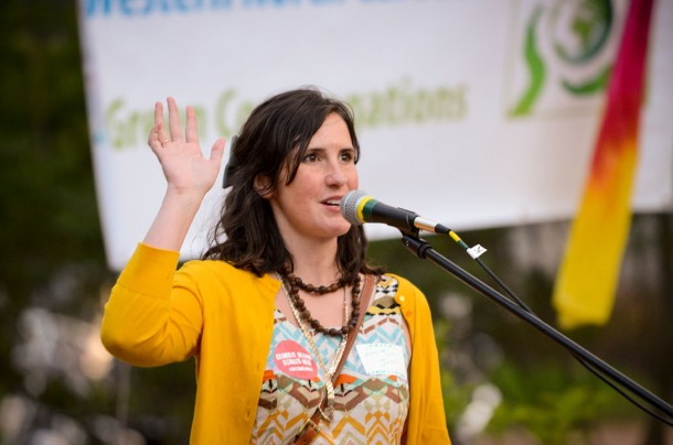 Anna Jayne Joyner speaks at a recent WNC Green Congregations vigil held on Earth Day in Asheville. Joyner and her father, Rick Joyner, are the subject of a Showtime documentary set to air on Sunday, May 4. Max Cooper/Carolina Public Press