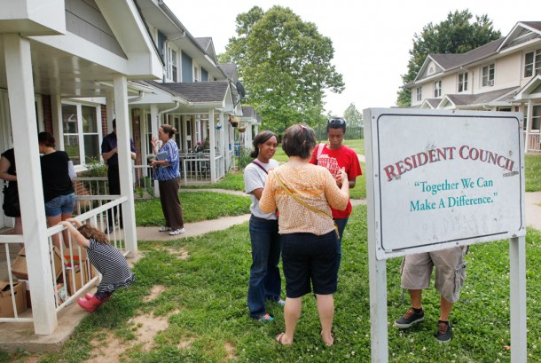Residents gather outside Hillcrest Apartments, one of 12 public housing developments in Asheville, after discussing concerns about a proposed conversion to a new federal funding and management program for Asheville's public housing. Matt Rose/Carolina Public Press