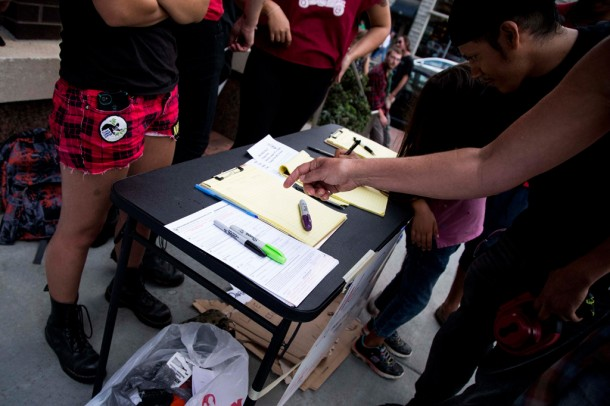 Volunteers registered people to vote on Sunday during an Asheville rally protesting police brutality following the shooting death of Mike Brown in Ferguson, Mo. Alicia Funderburk/Carolina Public Press