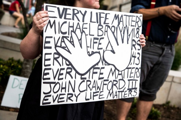 A protestor in Asheville on Sunday holds a sign referencing the shooting death of 18-year-old Michael Brown on Aug. 9 in Ferguson, Mo. Alicia Funderburk/Carolina Public Press