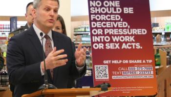 Josh Stein unveils anti-human-trafficking signs.