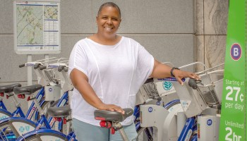 Dianna Webb demonstrates how to rent from Bcycle in Charlotte.